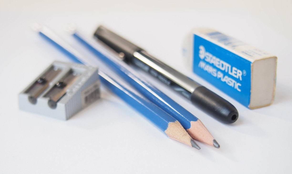 Pencils, ball-point pen, pencil sharpener and a block eraser.